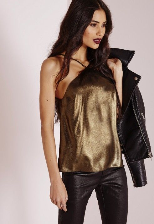 "Sprinkle some sass in this seriously slinky metallic top. Featuring spaghetti straps and a loose, relaxed fit, pair with ripped black skinnies and strappy heels or a leather mini. You go girl.  Approx length 50cm/19.5"" (Based on a UK size ..."