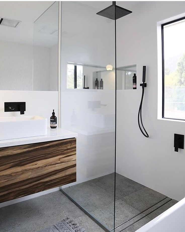 Tasmanian timber vanity with white top. White free standing basin, white matte black tap, mixer and rain shower head. Project by - @taslifewithmyboys #taps #interiordesign #bathroom #australia #architecture #bathroomdesign #bathroomcollective Visit our website for more www.bathroomcollective.com.au