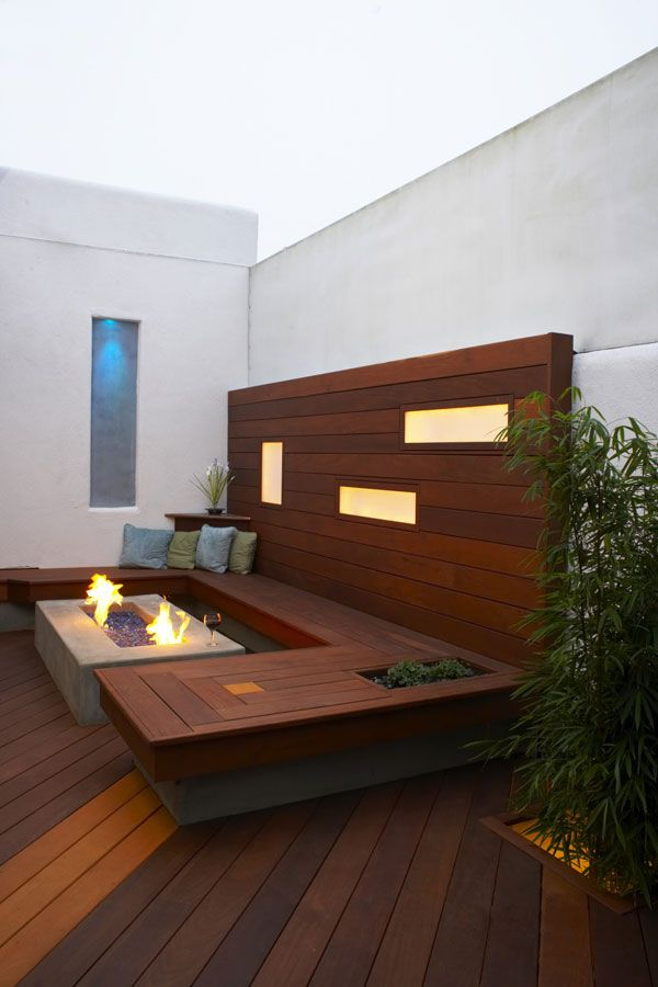 Modern deck designed with seating around fire pit