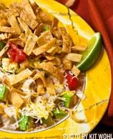 Rick Bayless tortilla soup from the best Mexican gourmet in Chicago.  Rick buys his peppers in Mexico, but I just use a can of whole green chiles. Leave out the chicken broth and you have an awesome restaurant style chip salsa too.