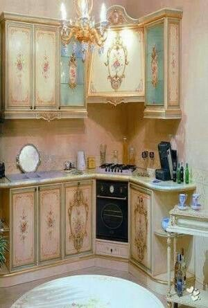 Shabby Chic Cabinets. This is way over the top but that is what being a girl is all about. I can love this without ever wanting it in my house. We all want things, even things we cant or wont have :)