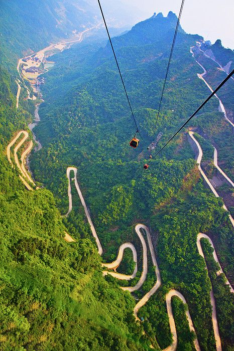 View of mountains and winding road in Mount Tianmen, National Forest Park in western Hunan province of China