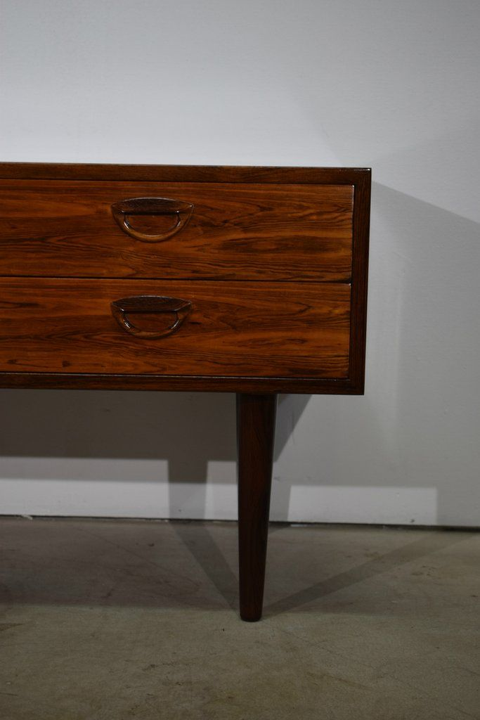 Danish mid century rosewood dresser/ hallway unit with four drawers. Rosewood veneer and tapered solid rosewood legs.Designed by Kai Kristiansen. Produced by Fe