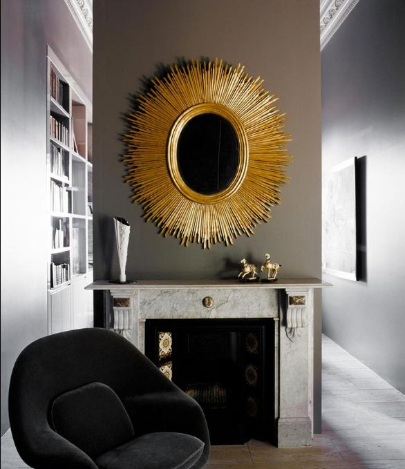 Greige and Gold. Stunning metallic mirror on a gray wall, over a marble fireplace.