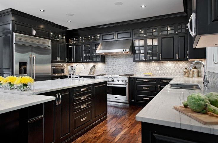 Black kitchen cabinets-love the cabinets with the glass fronts and the island. The floor is awesome. I think I would do the cabinets in grey though.