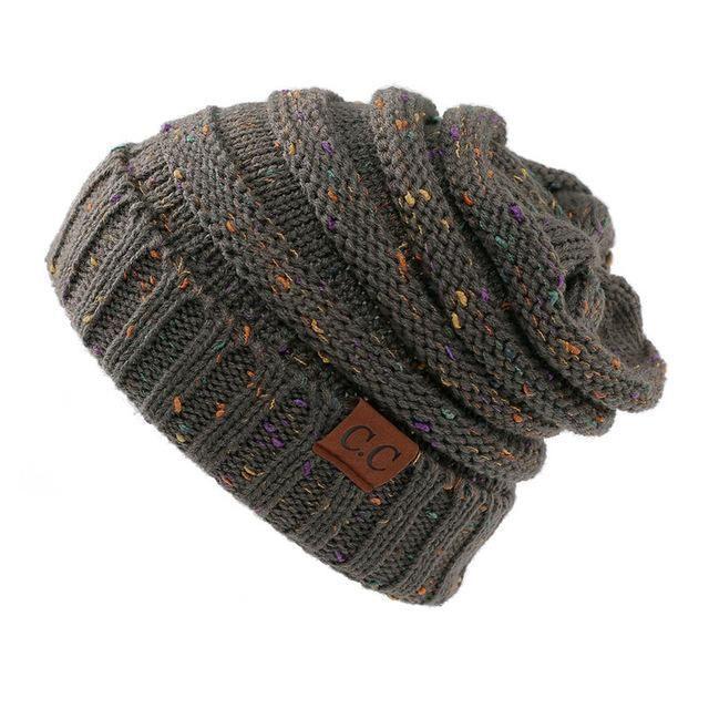 49fcbdba78f 2018 CC Warm Winter Hat For Women Ponytail Beanie Stretch Cable Knit Messy  Bun Hats Soft