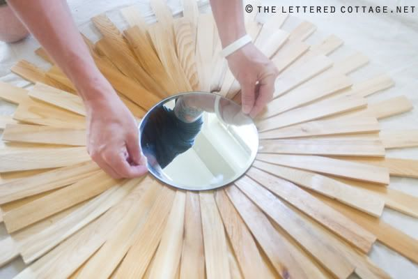 paint sticks and a cheap round mirror....do this and spray paint the sticks silver or gold!