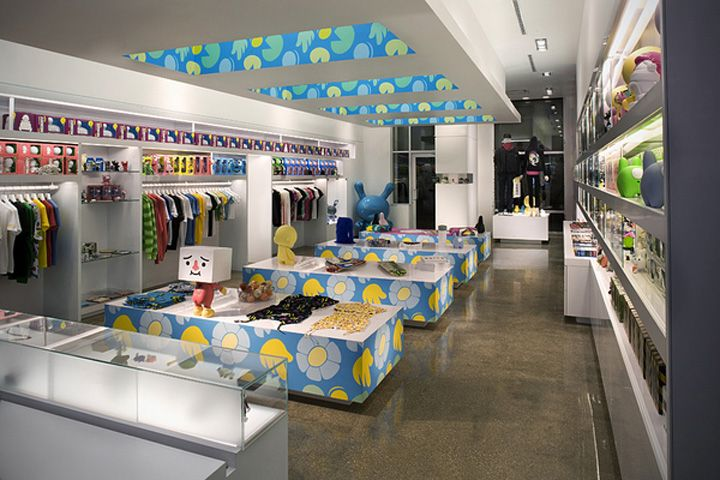 Kid Robot store by Mash Studios Miami-prints on the sides of tables