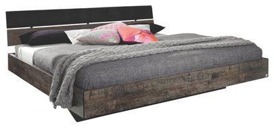 <div>Dieses Bett von <b>CARRYHOME </b>überzeugt mit einzigartigem Design: Dank der lackierten Oberfläche in Braun und Schwarz wertet das Bett Ihr Schlafzimmer mit chicer <b>Vintage-Optik </b>auf. Die Verarbeitung aus einer hochwertigen Flachpressplatte trägt zur Robustheit Ihres modernen Betts bei. Auf einer Liegefläche von ca. <b>140 x 200 cm</b> (B x L) finden Sie komfortabel Platz zum Schlafen. Die chice, zweigeteilte <b>Rückenlehne </b>verleiht dem Bett den letzten Schliff. Dieses Bett…