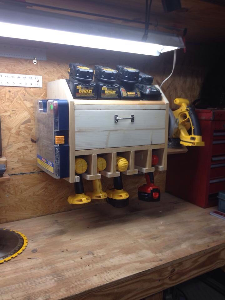 Drill charging station with storage shelf