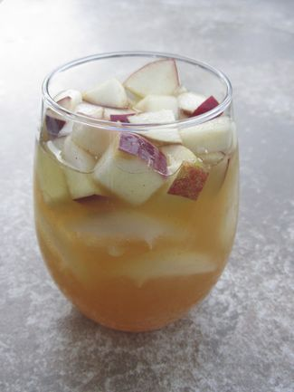 Apple Cider Sangria  1 bottle of white wine, we used Pinot Grigio 1/2 cup apple brandy 2 1/2 cups apple cider 3 apples, cubed cinnamon simple syrup* ginger ale  For cinnamon simple syrup: 1/2 cup sugar 1 tsp ground cinnamon 1 tsp vanilla 1 cup water