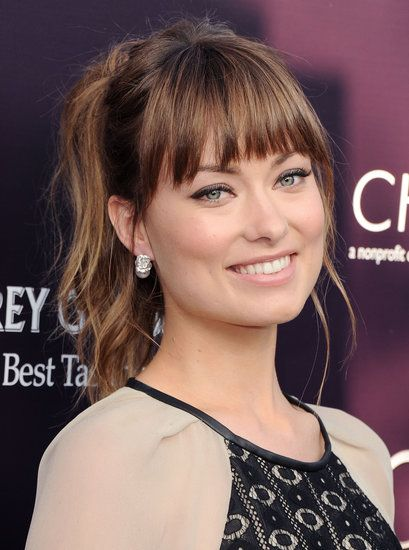 Happy Birthday! See Olivia Wilde's Winning Hair and Makeup Moments: It was a flirty, textured ponytail with bangs for Olivia at the 2011 Butterfly Ball — the perfect style to show off her two-toned hair color.
