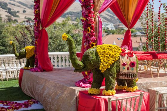 Elephant floral centerpieces are the perfect touch for this Hindu wedding ceremony. Event Design + Flowers: Anaïs Event Planning and Design Wedding Venue: The Fairmont Hotel Photographer: Wedding Documentary