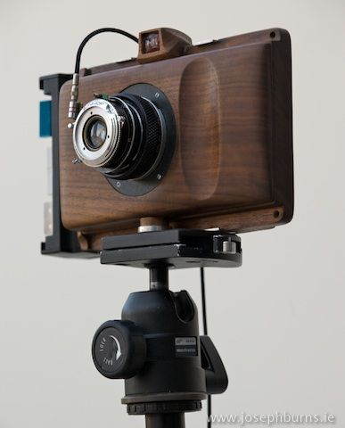 Fabulous HandCarved Cameras by Joseph Burns. He has shots from beginning to end and actual photo quality. They don't make 'em this good. WOW! http://josephburns.ie/gallery.php?searchterm=pktre