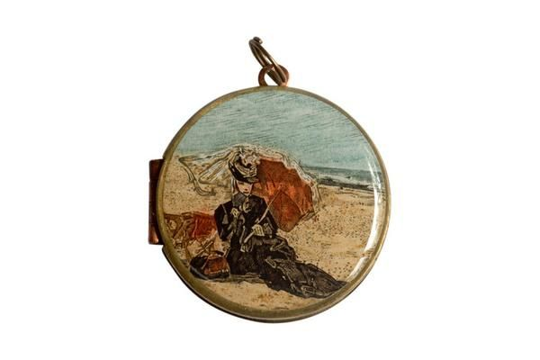 Featuring the Eugene Boudin painting Woman With A Parasol, this French postage stamp was released in 1987.  The vintage locket is made from brass and copper and measures 30mm in diameter. The locket opens from the side and is capable of holding 2 of your most precious memories inside.