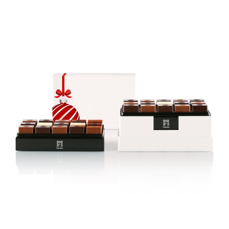 Celebrate the season with this chic red and white box, laden with zChocolat's entire numbered collection of chocolates created by Pascal Caffet, World Champion Chocolatier — a delectable must-have around the Christmas tree. [USD 82.69] Discover our Holiday zBox 30: http://www.zchocolat.com/shop/en/holiday-collection/336-holiday-zbox-30.html