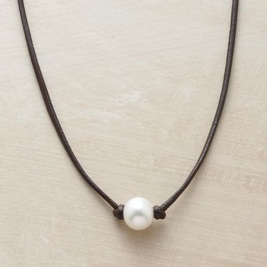 """Simply knotted on a leather strand, a cultured pearl's inborn luster becomes all the more enchanting. Sterling hook and leather loop closure. Handmade in USA by Rebecca Lankford. 16""""L."""