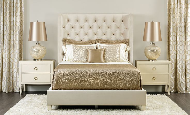Champagne Dream: Let your love for champagne inspire your bedroom with this gold and cream-colored sanctuary. The delicate colors let details sing, like the velvet headboard's subtle curved wing and intricate button tufting, pearly, geometric drapes, and sumptuous satin bedding. $ $1,849.00