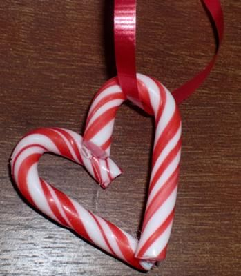 What it looks like after the glue and the ribbon. I went to the local dollar store and spent two dollars on a two boxes of mini candy canes. Then an extra dollar on snowflake cellophane I planned on wrapping