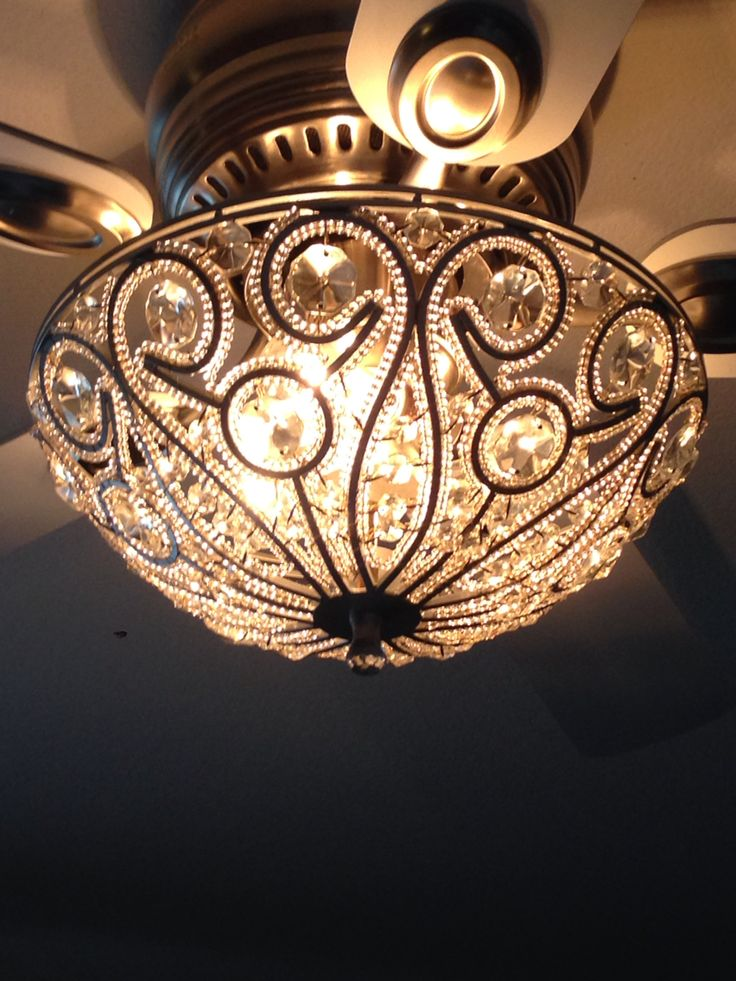 Tired of the boring ceiling fan light kits? Buy a sparkly flush mount fixture with the hole in the center!