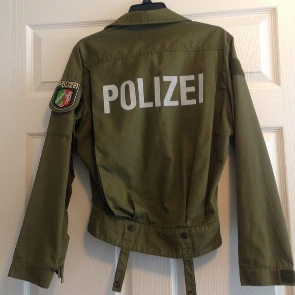 Vintage German police jacket This army green German police jacket was a gift, but it doesn't really match my style. It says Polizei on the back in silver reflective letters. There's a patch on the left arm and it zips all the way up the front. No size is listed but it fits like a medium. It's in great condition. Flexible on the price. Jackets & Coats Utility Jackets