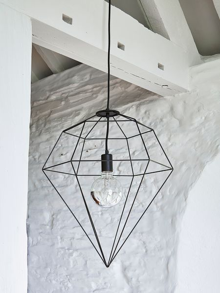 If you are looking to add an industrial vibe, this large black wire pendant will do so to perfection.