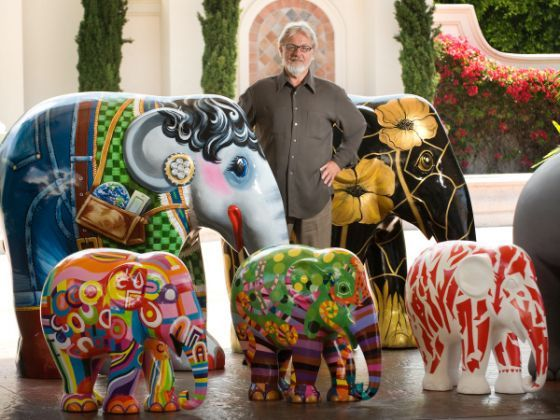 Dana Alan Yarger, ambassador for Elephant Parade USA, poses with some of the painted elephants that soon will be on display across Dana Poin...