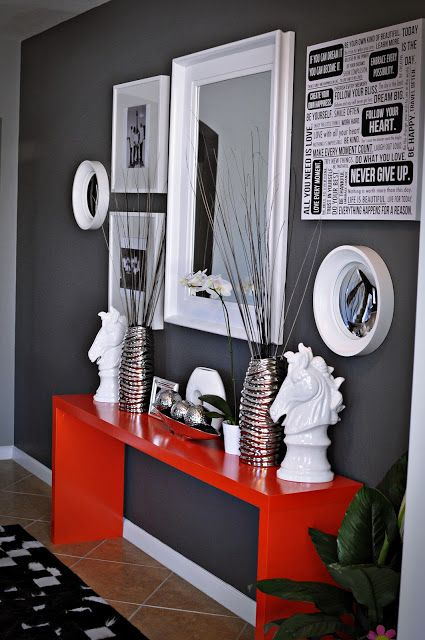 Love this entryway . . . get pop of color! Wish I had the discipline to go mainly white, black, and gray so the red could be a pop of color.    Source: LiveLaughDecorate: April 2012: