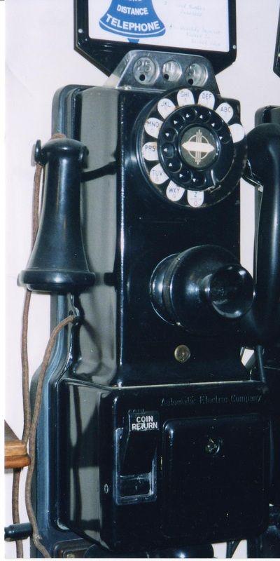 Single slot dial pay phone. Green: quantity 1. Circa 1950. India. - Grant's Telephone Classics