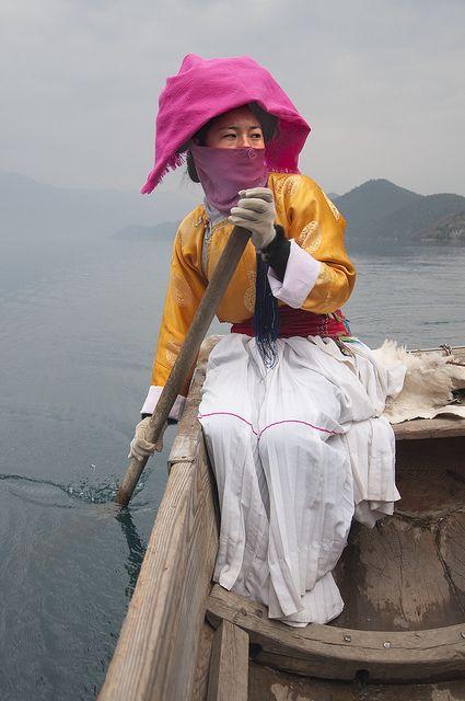 Mosuo Woman at Lugu Lake, Yunnan, China | In #China? Try www.importedFun.com for award winning #kid's #science |