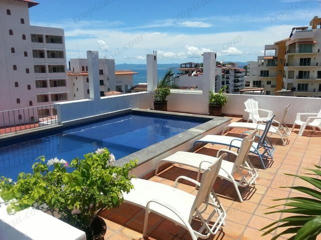 http://www.tropicasa.com/Puerto_vallarta_real_estate_Zona%20Romantica_957.html - Just two blocks from Los Muertos Beach, on a small street in front of the Tropicana hotel sits this spacious condo.  This condo features a living room and separate dining room, kitchen, separate...