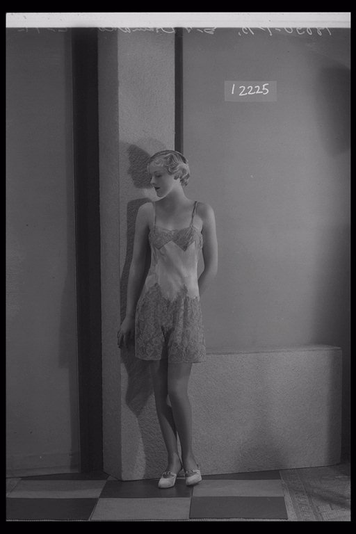 Glass Half Plate  Image of a woman modelling lingerie for Derry & Toms. Published in Illustrated Sporting & Dramatic News.    Maker:  Bassano Studio  Production Date:  1934-11-02