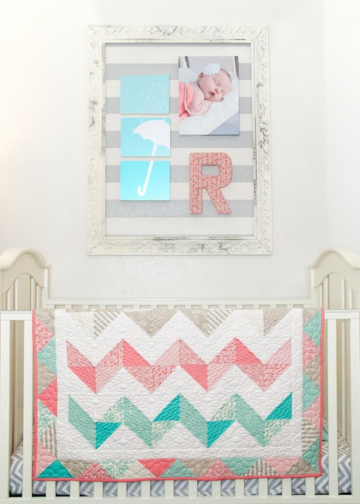 reese's amazing chevron baby quilt with framed striped wall. #baby #decor #teal #coral