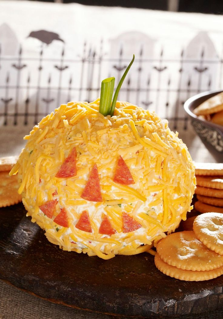 Cheesy Jack-o'-Lantern — This cheese ball appetizer recipe only takes 10 minutes to put together and resembles a pumpkin picked straight from the patch. It's so easy to make, it's scary! The best part? The KRAFT Shredded Cheese that covers the outside and the OSCAR MAYER Pepperoni—sure to bring a smile to the faces of your Halloween party guests. This is one starter you'll want to make sure to include on your monster menu.