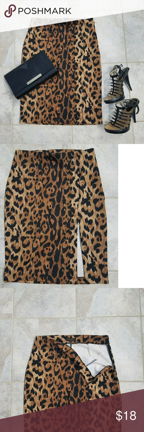 The Limited, leopard pencil skirt Comfortable and sexy. Stretchy leopard pencil skirt. Has hidden zipper slit that you can keep closed or unzip for a sexy slit. Hits at knees. The Limited Skirts Pencil