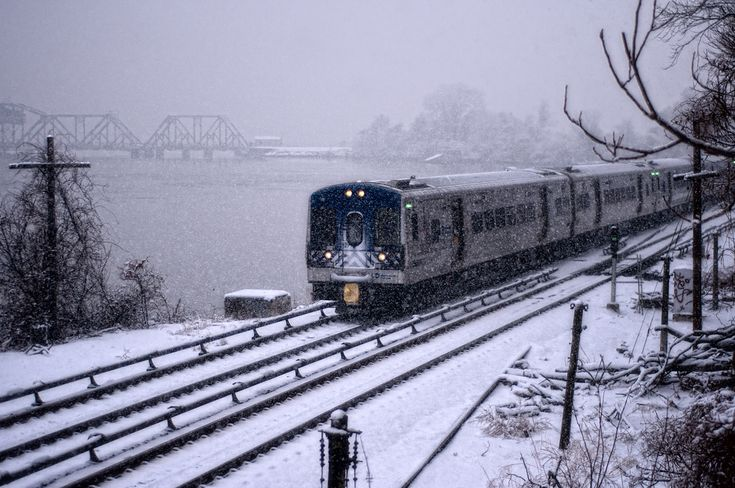 © 2011 Steve Kelley  Image of the Harlem River, Hudson river, Metro-North Railroad Train / Tracks, and the Amtrak trailroad bridge during a snowstorm from near the Spuyten Duyvil Metro North Station in the Riverdale neighborhood of Bronx, NY looking North - West.  Nikon d300