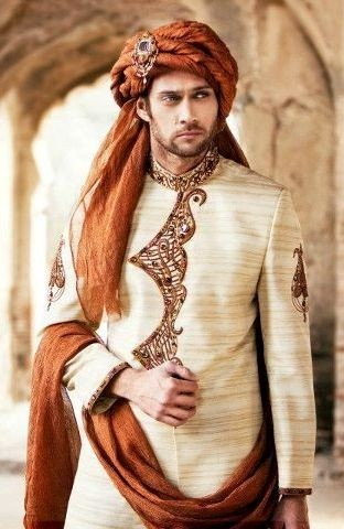 Cream and burnt orange - understated and elegant. Love the minimalistic degin down the front. #indian #wedding #groom