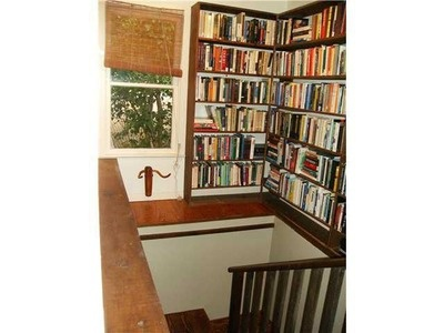 English style gallery shelving in stairwell