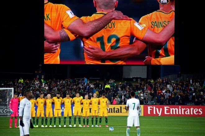 "Australian players linked arms as a sign of respect before Thursday's World Cup qualifying match at Adelaide Oval. Saudi players took up field positions and some continued to stretch. Football officials said they had been told in advance that the ""tradition was not in keeping with Saudi culture"". An Australian MP called it ""disgraceful""."