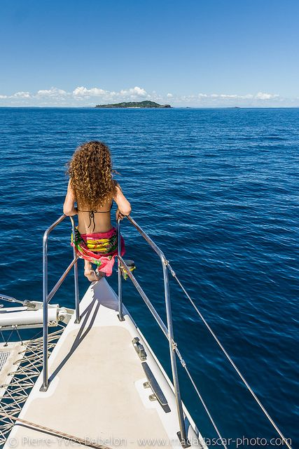 Young woman on a catamaran by Pierre-Yves Babelon, via Flickr