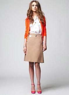 orange cardigan + camel skirt