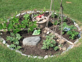 Mothering with Mindfulness: Outdoor Play Space (picture is of child's real garden; rocks are from places they have visited)