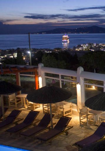 Evening views over Chora and the Aegean Sea from the Anastasios Sevasti Hotel in Mykonos, Greece