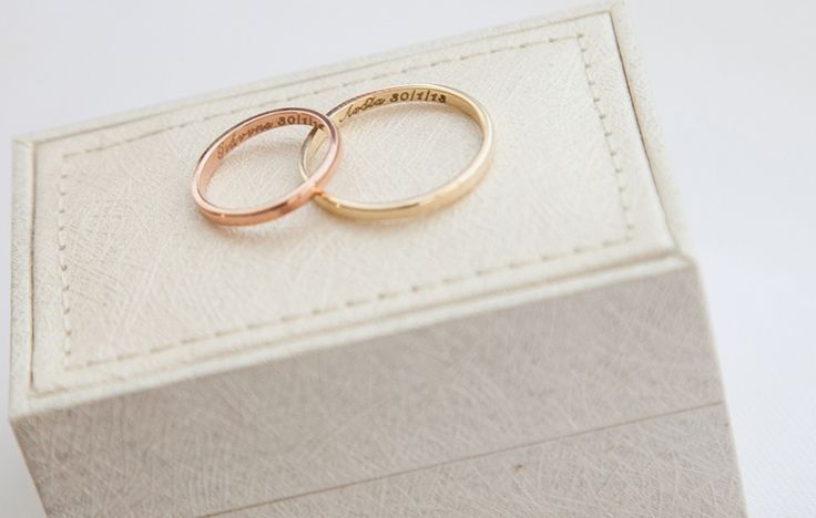 His and hers wedding bands, yellow and rose gold, engraved with the couple's names and wedding date- Mitheo Events | Concept Events Styling