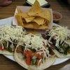 Taco Deluxe: carne asada, pollo y carnitas
