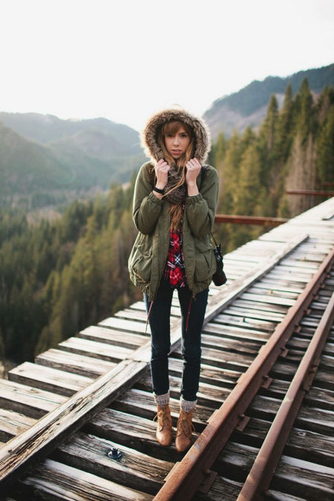 Black pants + army jacket parka with a furhood + combat boots + boot socks + flannel. Weekender outfit brought to winter!