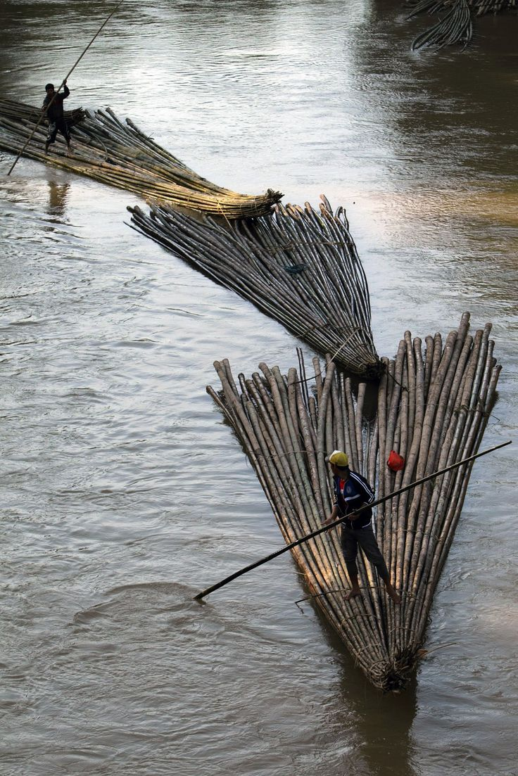 Villagers transport bamboo downriver to sell in Lebak regency, Indonesia's Banten village. (Reuters)