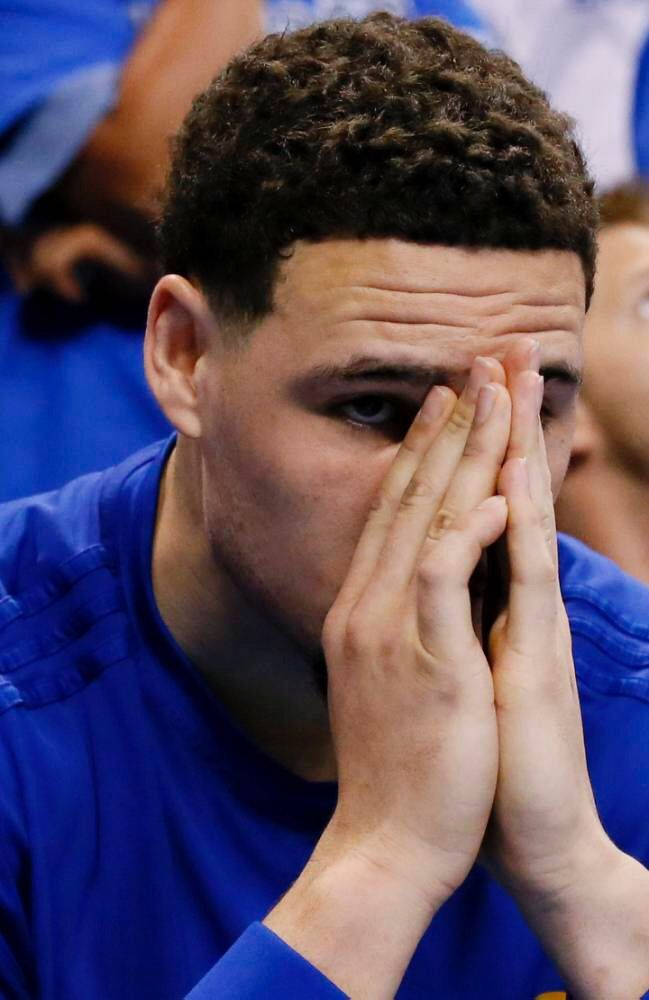 Golden State Warriors guard Klay Thompson (11) watches from the bench against the Oklahoma City Thunder during the second half in Game 6 of the NBA basketball Western Conference finals in Oklahoma City, Saturday, May 28, 2016. (AP Photo/Sue Ogrocki)