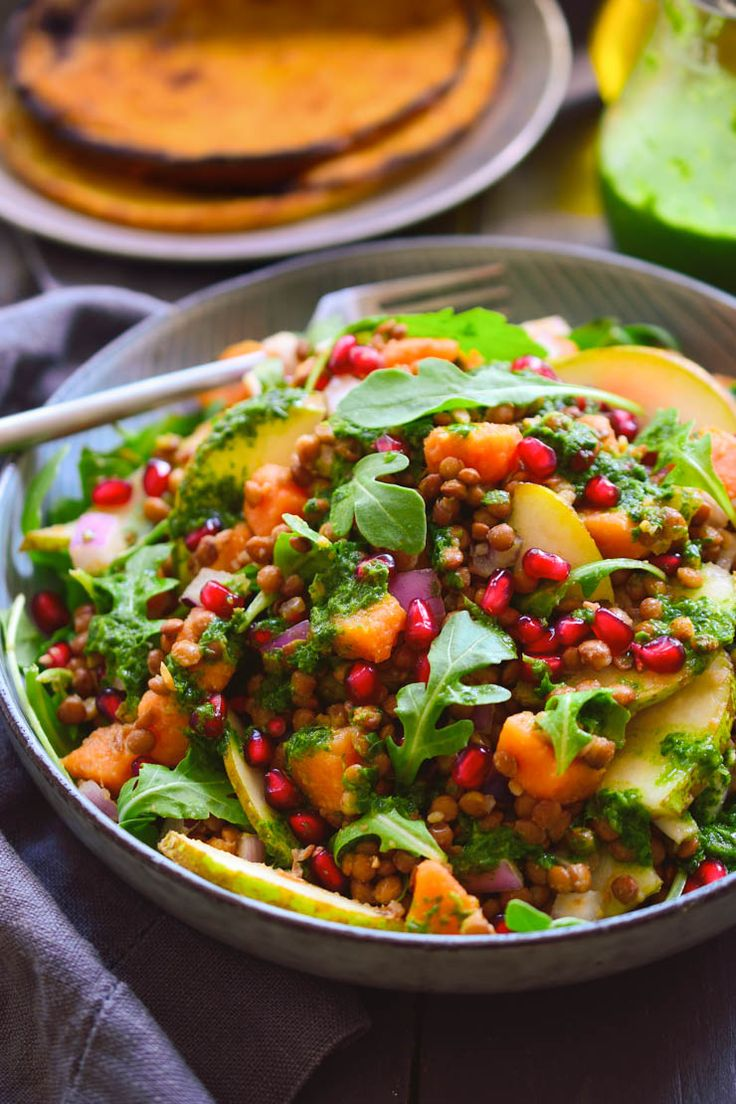 This autumn lentil salad served over chickpea pancakes is a protein-packed meal that's easy to make and makes use of the best of the season's produce.