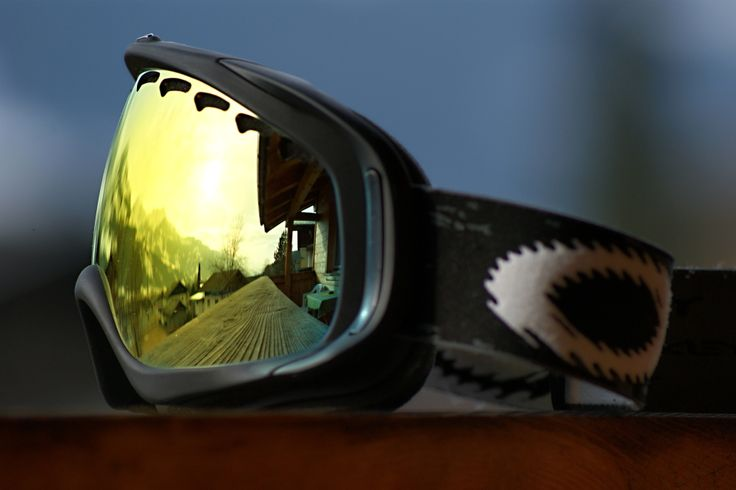 Sunrise in snowboard googles Oakley Crowbar Fire Iridium Matte Black, Zell am See, Austria.